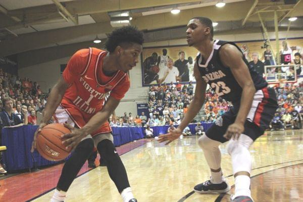 Trent Frazier looks for an opening as Gonzaga's Zach Norvell closes in, Monday night at the Maui Invitational in Lahaina, Hawaii