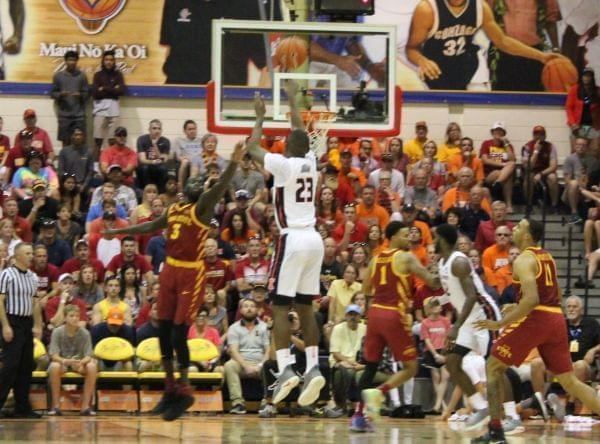 Illini basketball player Aaron Jordan scoring a three-pointer against Iowa State at the Maui Invitational.