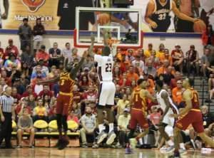 Illini basketball player Aaron Jordan scoring a three-pointer against Iowa State at the Maui Invitational.