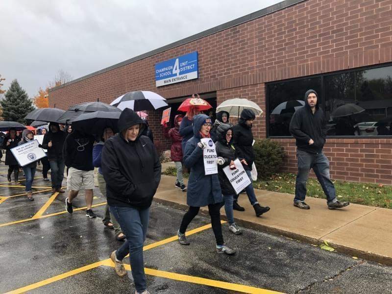 Teachers from Champaign's Unit 4 school district picket outside of the district's administrative offices, Thursday, Nov. 1, 2018.