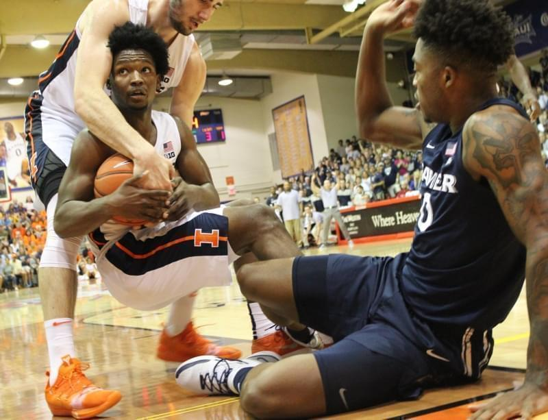 Illini Giorgi Bezhanishvili & Andres Feliz wrestle the ball from Xavier's Tyrique Jones.
