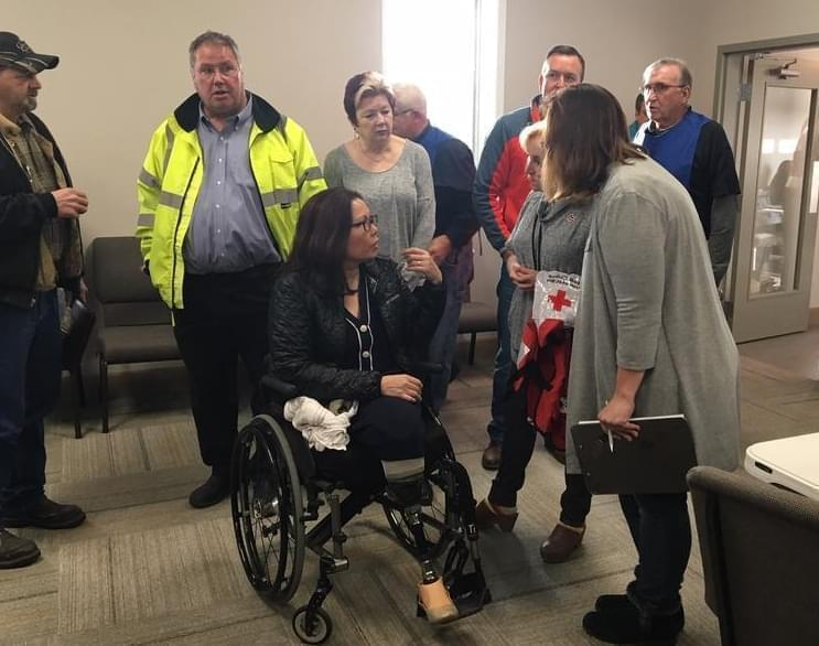 U.S. Sen. Tammy Duckworth meets with first responders Friday during a visit to Taylorville.