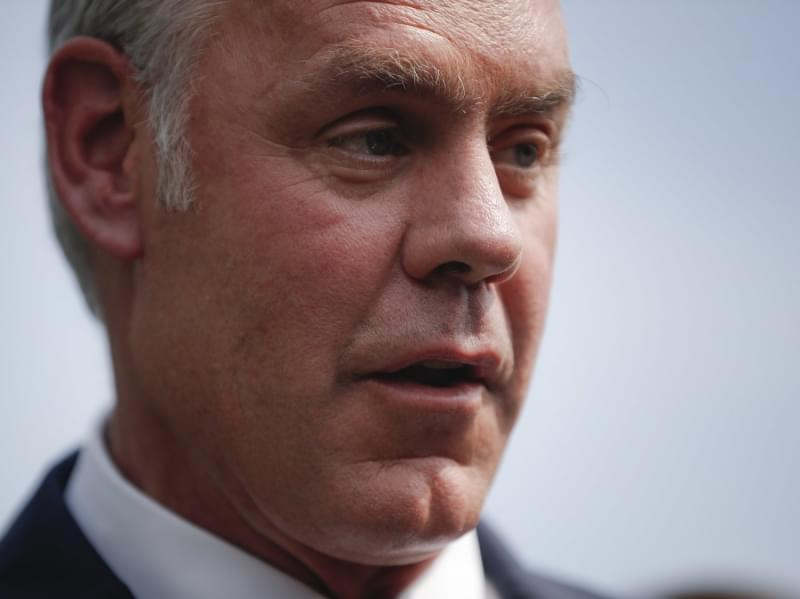 Interior Secretary Ryan Zinke speaks to members of the media outside the White House in August.