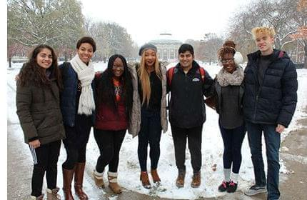 U of I students standing outside on the campus. The YouMatter Studios team includes (from left to right) Sanskriti Khurana, Adia Ivey, Daja Wilson, Jewel Ifeguni, Vignesh Sivaguru, Deborah Agoye, and Jake Pisarski.