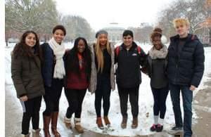 U of I students standing outside on the campus. The YouMatter Studios team includes (from left to right) Sanskriti Khurana, Adia Ivey, Daja Wilson, Jewel Ifeguni, Vignesh Sivaguru, Deborah Agoye, and Jake Pisarski.