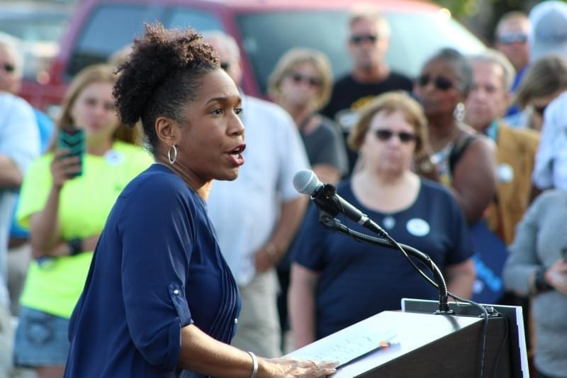 In this file photo from 2017, state Rep. Juliana Stratton stands at a campaign podium at a union rally in Springfield.