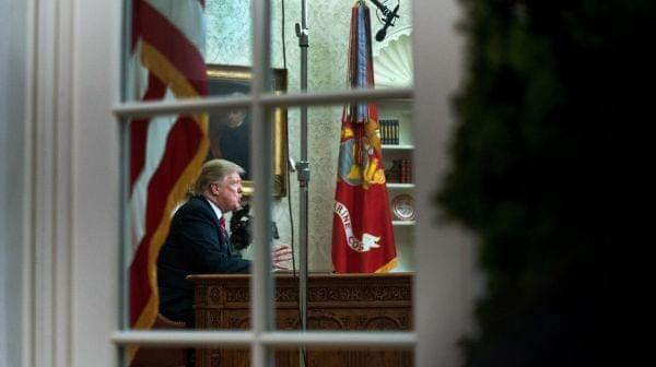 President Trump speaks to the nation in his first-prime address from the Oval Office of the White House on Tuesday.