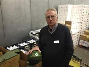 Inside the walk-in cooler at the Food Bank of Lincoln, Nebraska, director Scott Young has milk and fresh fruit from the federal government thanks to a trade-mitigation program that delivered the food despite the partial shutdown.