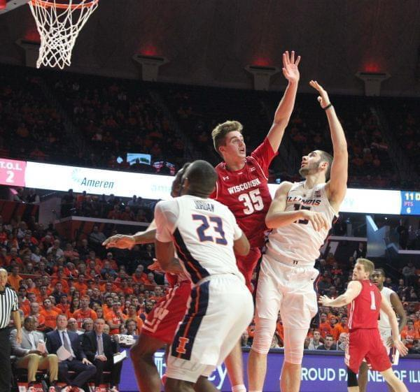 Giorgi Bezhanishvili scores a hook shot over Wisconsin's Nate Reuvers.