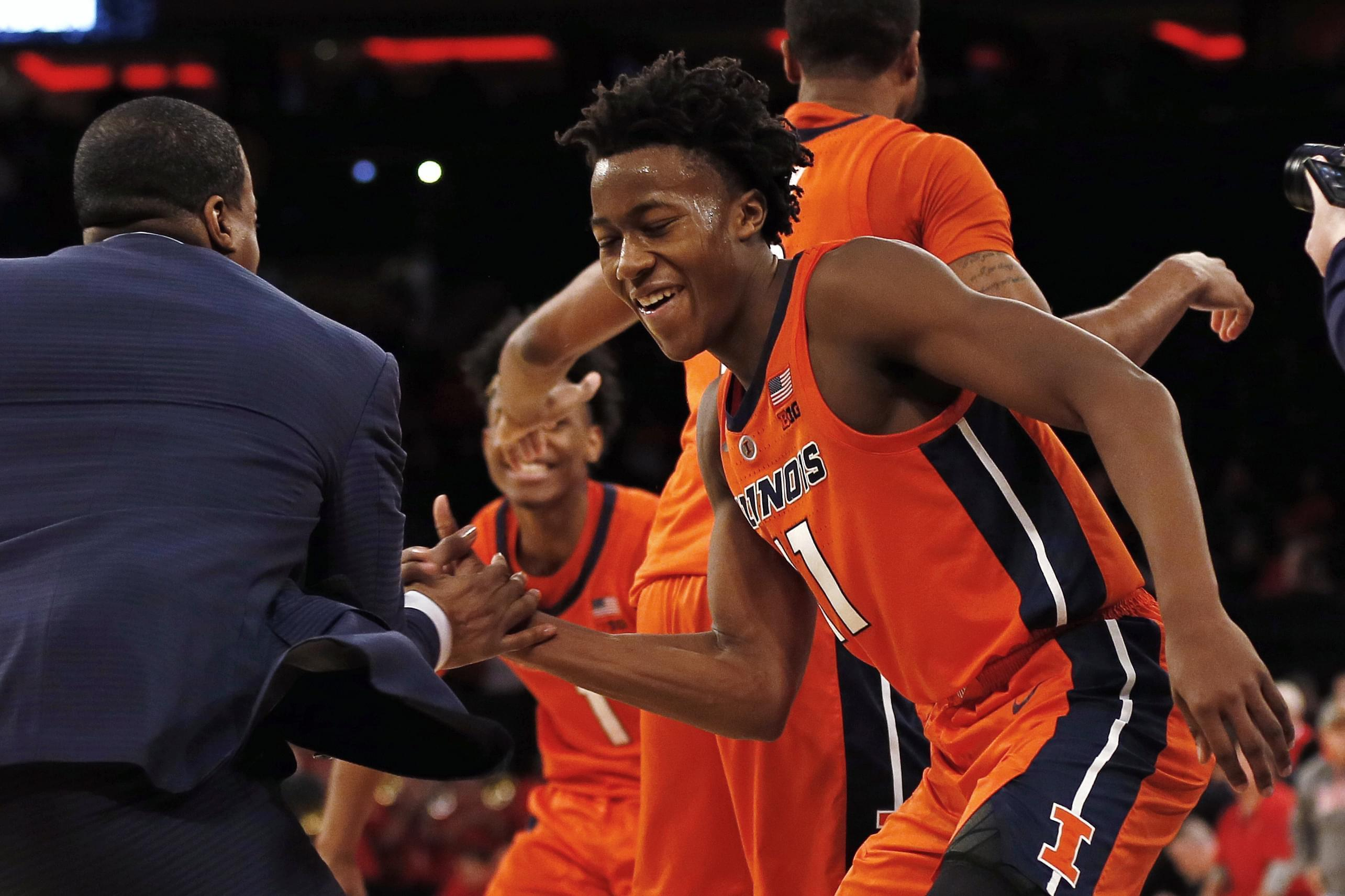 Illinois guard Ayo Dosunmu (11) celebrates with a coach after defeating No. 13 Maryland 78-67 in an NCAA college basketball game Saturday, Jan. 26, 2019, in New York. Illinois defeated Maryland 78-67.