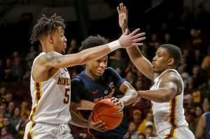 Illinois' Trent Frazier (1) tries to go between Minnesota's Amir Coffey (5) and Isaiah Washington (11) during the second half of an NCAA college basketball game Wednesday, Jan. 30, 2019, in Minneapolis.