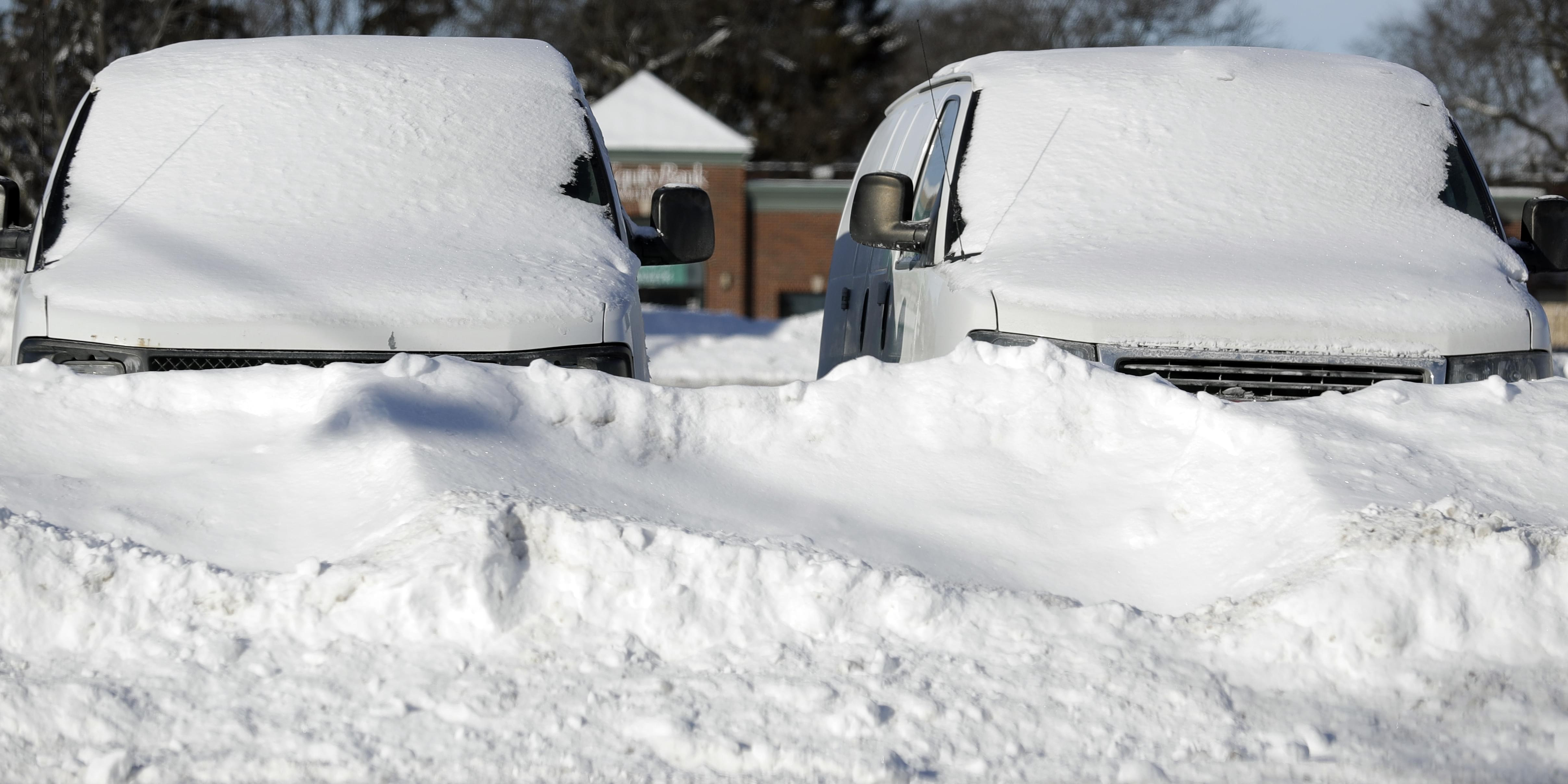 Cars are covered by snow in Buffalo Grove, Ill., Thursday, Jan. 31.