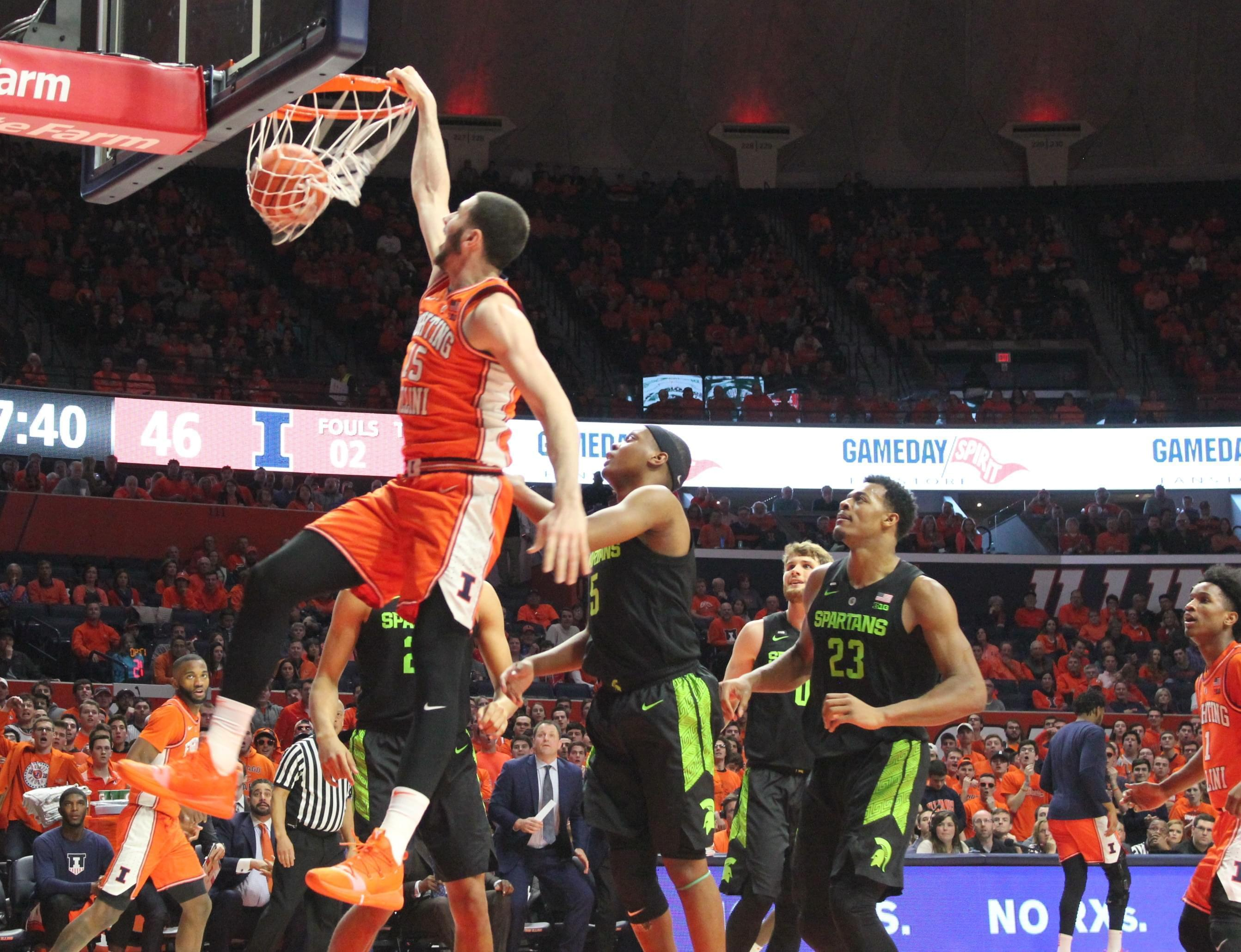 Illinois freshman Giorgi Bezhanishvili slams home two points during Illinois' 79-74 win over #9 Michigan State Tuesday night in Champaign.