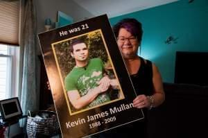 Kathi Arbini holds a photograph of her son, Kevin Mullane, who died of a heroin overdose at the age of 21.
