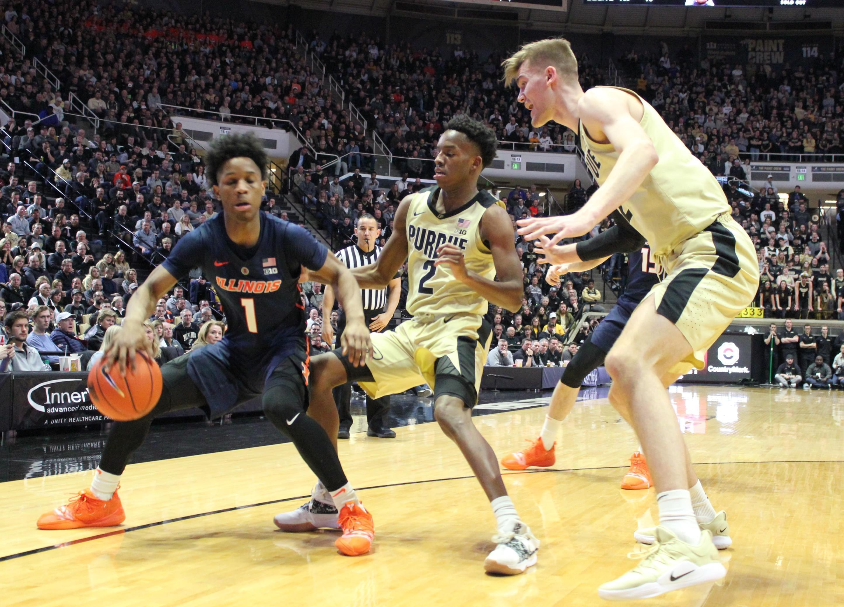 Purdue's Matt Haarms (right) and Eric Hunter defend Illinois' Trent Frazier during Purdue's 73-56 win Wednesday night in West Lafayette, Indiana.