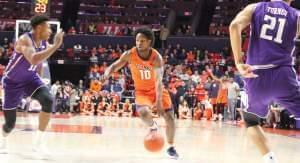 Illinois' Andres Feliz spies an opening between Northwestern defenders, Sunday in Champaign.