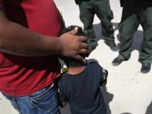 father and son at US-Mexico border