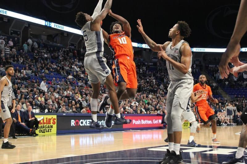 Illinois' Andres Feliz drives against Penn State's Jamari Wheeler and Lamar Stephens