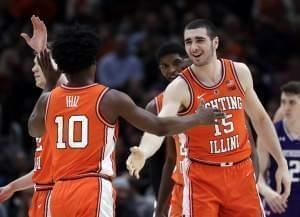 Two Illinois basketball players slapping hands in congratulations