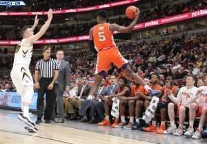 The Illini bench watches teammate Tevian Jones save a loose ball during a Big Ten Tournament loss to Iowa on Thursday in Chicago.