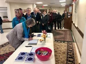 Champaign-Urbana community members enter the Central Illinois Mosque and Islamic Center for a vigil in remembrance of the victims of the Christchurch attack.