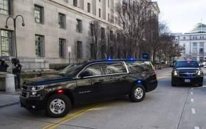The motorcade for Attorney General William Barr arrives at the Department of Justice, Sunday in Washington.