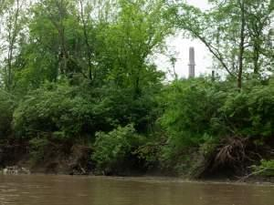 The smokestack of Dynegy's shuttered Vermilion Power Station towers over the Middle Fork River.