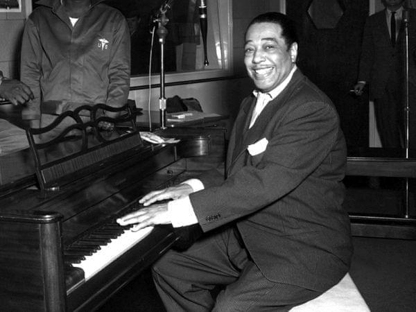 Ellington poses with his piano at the KFG Radio Studio November 3, 1954.