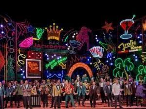 people perform on a vegas themed stage