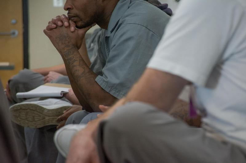 Men at the Eastern Reception, Diagnostic and Correctional Center in Bonne Terre, Mo. listen to a philosophy discussion hosted by the St. Louis University Prison Program.