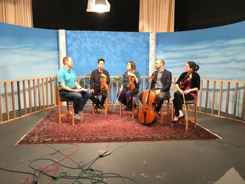 Illinois Public Media's Brian Moline and the Jupiter String Quartet in the WILL-TV studio.