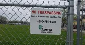 Sign on the fence surrounding the manufactured gas plant site owned by Ameren in Champaign.