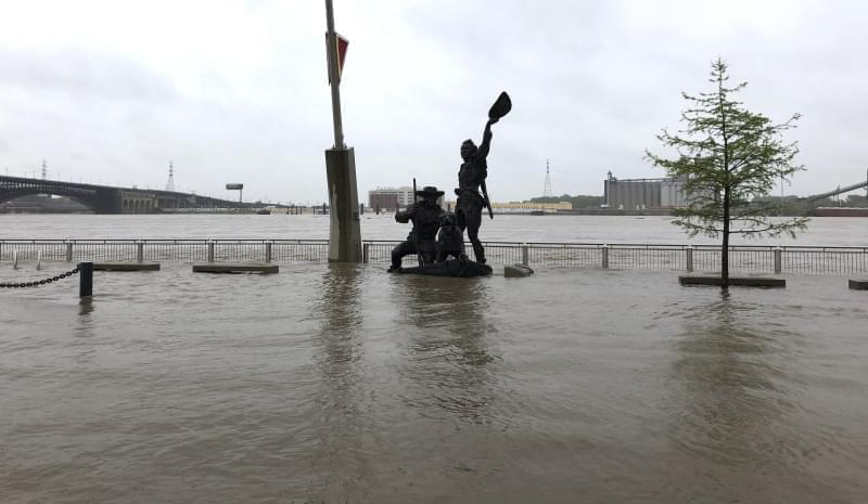 A statue of explorers Lewis and Clark is surrounded by floodwater along the St. Louis riverfront, Thursday, May 2, 3019. Several Mississippi River towns are seeing floods that are closing in on the historic levels reached in 1993.