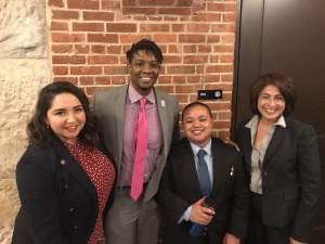 State Representatives Delia Ramirez and Elizabeth Hernandez, who sponsored the bill, flank advocates Myles Brady Davis (left) and Rowan Ewangan from Equality Illinois, who helped lobby for its passage.