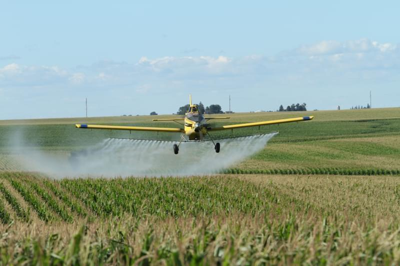 Fleets of specially-equipped planes can spray pesticides on cropland, including this Air Tractor owned by Meyer Agri-Air in Wellsburg, Iowa.