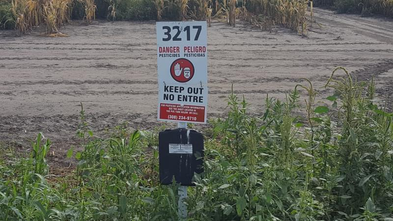 An EPA investigation found this sign in a Nebraska field. It provides information about pesticide applications in the area.