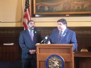 Gov. J.B. Priztker and DCFS Acting Director Marc Smith announced plans to overhaul the department's troubled Intact Family Services unit.