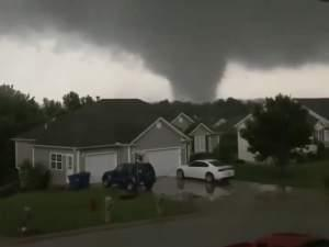 This still image taken from video provided by Chris Higgins shows a tornado on Wednesday in Carl Junction, Mo.