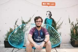 A young man sits outside Hola Code offices in Mexico City