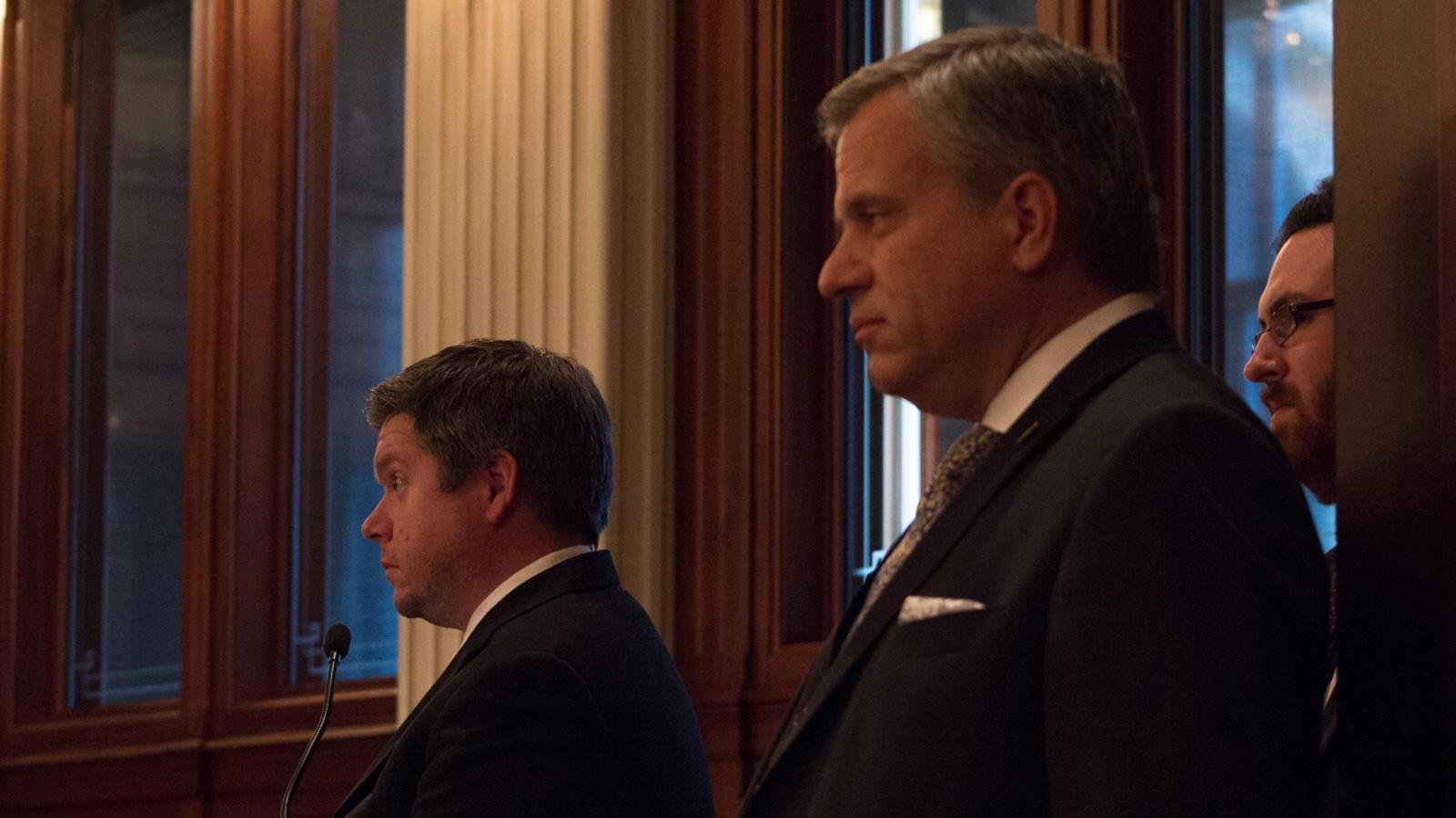Democratic state Reps. Mike Zalewski, left, and Rob Martwick listen to Republicans criticize a Democratic plan to move Illinois from a flat income tax to a graduated tax.