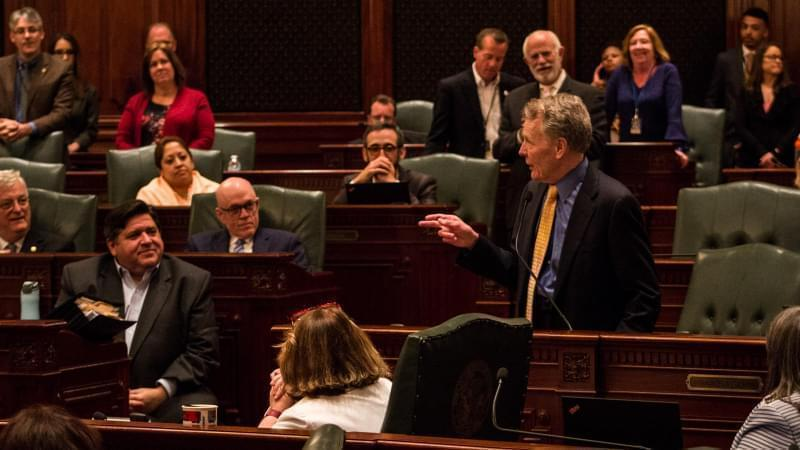 House Speaker Michael Madigan speaking to colleagues and Governor J.B. Pritzker
