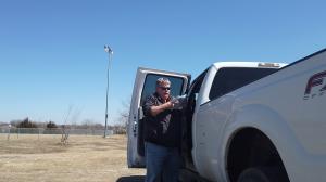 Mark Junker by his pickup truck.