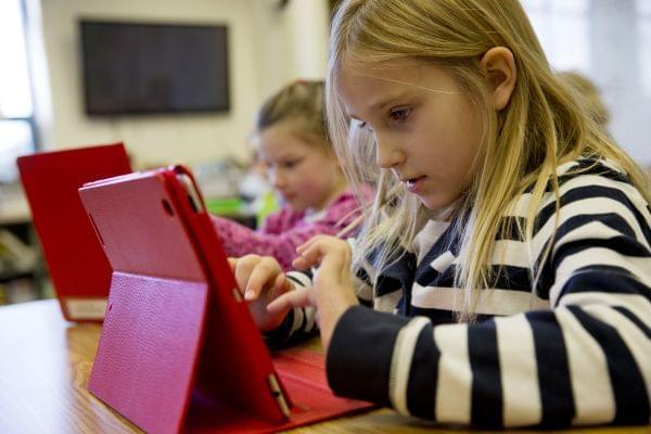 A second-grader works on an iPad.