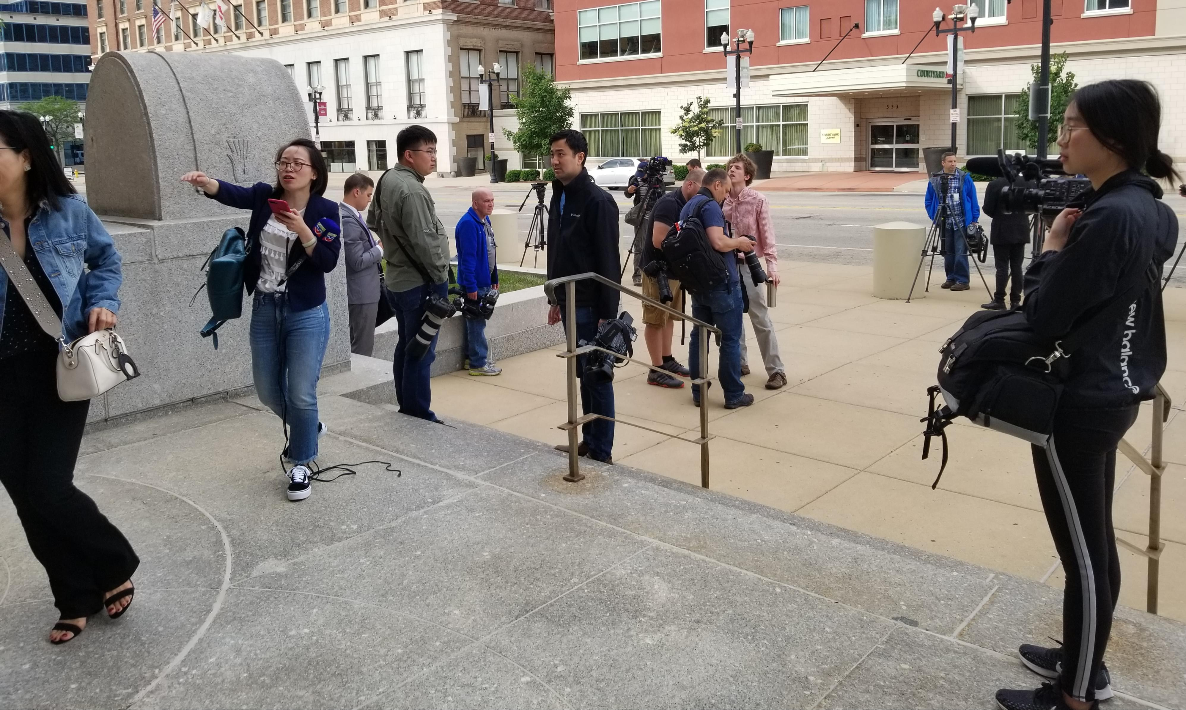 News media workers gathering outside the Federal Building & U.S. Courthouse in Peoria.