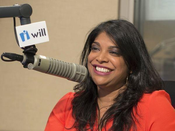 Niala Boodhoo sitting in front of a WILL microphone