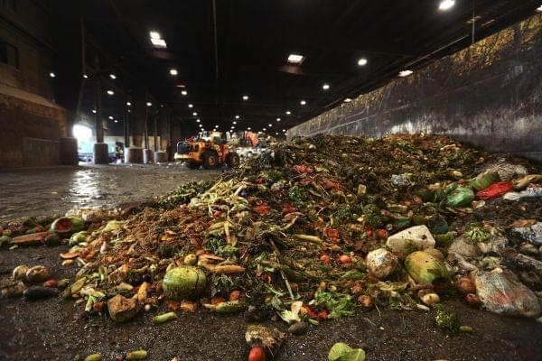 "In this Aug. 29, 2018, photo, at the Waste Management facility in North Brooklyn, tons of leftover food sits piled up before being processed into ""bio-slurry,"" in New York."