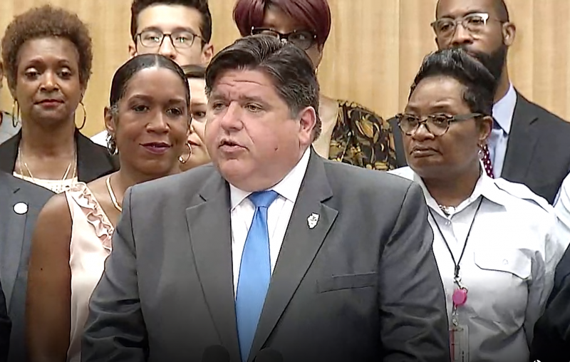 Gov. J.B. Pritzker addresses a crowd during a press event on Illinois' newly-signed state infrastructure plan in Chicago.