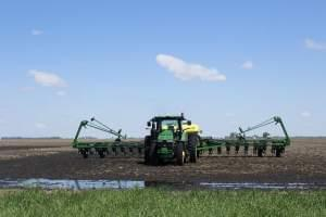 A tractor idled in a field that was too wet to farm in central Illinois this spring.