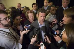 Rep. Adam Kinzinger, R-Channahon, speaks with members of the media during a news conference at the Republican congressional retreat in Philadelphia in 2017.