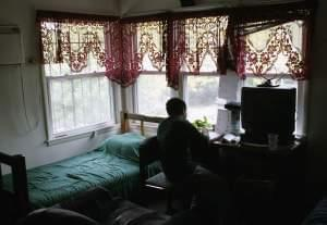 A resident at the International Children's Center in Chicago is seen in his room Oct. 19, 2006.